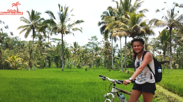 Cycling through rice paddy fields. The Bali Bucket List with 124 things to do! #girlswanderlust #Bali #Indonesia #wanderlust #travel.jpg