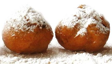 oliebollen. Dutch food bucket list - 30 Foods you must try in the Netherlands via @girlswanderlust.png